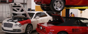 2 Ferraris and Bentley getting service